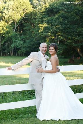 Wedding Couple with white fence