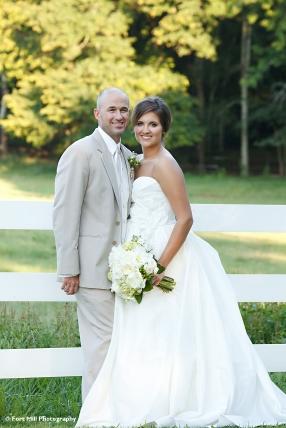 Wedding couple near pasture